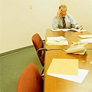 Businessman Reviewing Documents in Conference Room