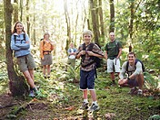 Group of hikers in forest, portrait