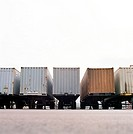 Cargo containers on trucks, rear view