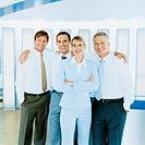 Businesswoman in front of three businessmen embracing, portrait