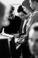 Group of business people examining document, close-up (B&W)