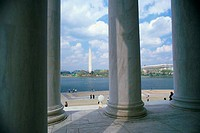 Columns at Jefferson Memorial with Washington Monument in background