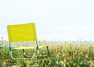 Folding chair in grass