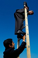 Businessmen Climbing a Ladder