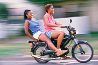 Women friends on motorbike