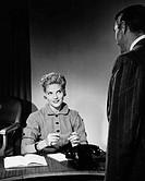 Woman sitting, listening to man