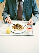 Businessman having lunch, close-up