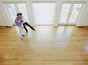 Couple embracing in empty house, elevated view