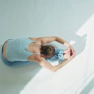 Woman practicing yoga, overhead view