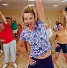 Female aerobics instructor and class, portrait