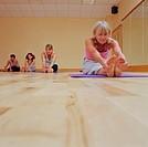Women stretching on gym studio floor