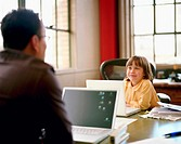 Father and daughter (4-6) using laptops in office (focus on girl)