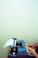 Man using typewriter, close-up of typewriter (grainy)