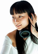 Young woman with headphones, smiling, close-up