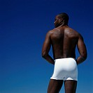 Young man wearing white briefs, rear view