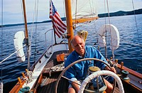Man Steering a Yacht