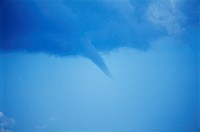 STORM AS FUNNEL CLOUDS FORMING TORNADO