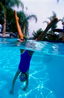 Girl Doing a Handstand in a Swimming Pool