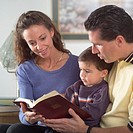Family reading Bible