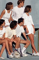 Group of young people watching tennis