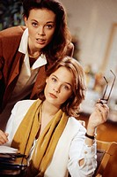 Two women working in office, waist-up