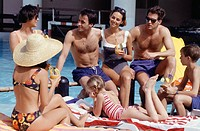 Group of people sitting at swimming pool