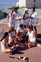 Group of eight people on tennis court