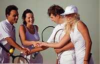 Tennis players shaking hands on tennis court