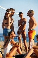 Group of friends at beach volleyball court
