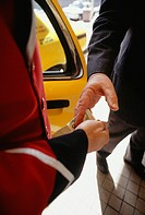 Businessman tipping bellhop, Close-up of hands