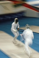 Seoul Olympics, two fencers fencing, (blurred motion)