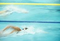 Two men swimming in pool, Seoul Olympics, (blurred  motion)