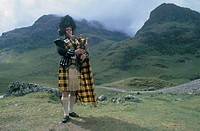 great britain, scotland, highland, a bagpipe player