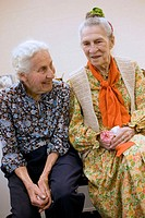 Two friends, woman age 90 on right has Alzheimer's disease, Boston. Massachusetts. USA