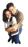 a young adult couple embrace as they both smile up at the camera