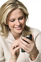 medium shot of a young adult woman as she checks some items on her electronic planner