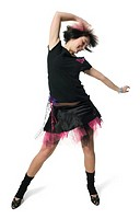 a caucasian teenage girl in a black and pink punk outfit dances playfully