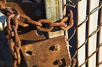 Old padlock on gate