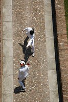 Aerial view of two fencers fencing on a bridge