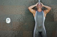 Male Swimmer Taking a Shower