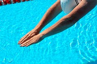 Hands of Male Swimmer Diving