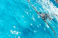 High Angle View of Female Swimmer Swimming Backstroke