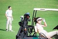 Woman relaxing on a golf cart