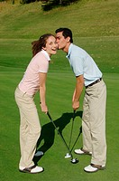 Man kissing his golf partner on the cheek