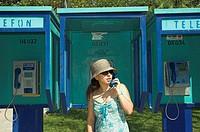 Young woman on public pay phone. Fethiye, Turkey