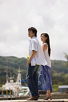 Couple standing in harbour