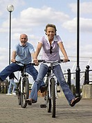 Mature couple riding bicycles (thumbnail)