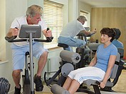 Mature couple using gym equipment