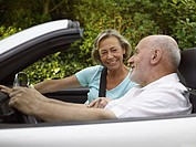 Mature couple in a convertible