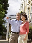 Mature couple in suburban street